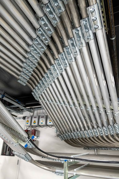 全部容量,材料处理系统将涉及大约5英里的管道。