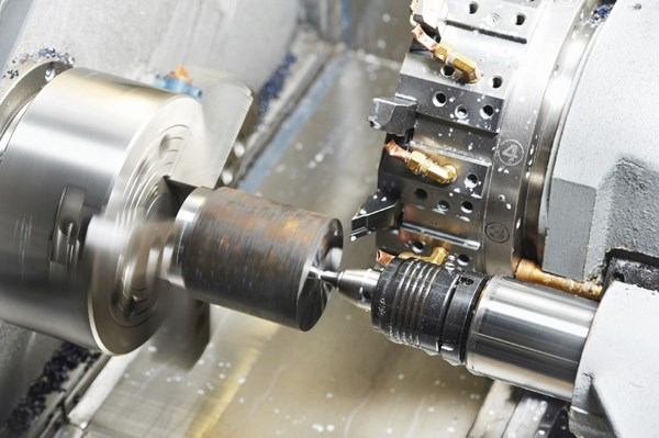 stock photo of a lathe turning a part