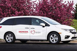 Honda modified its Odyssey minivan to help protect drivers transporting people to be tested for COVID-19