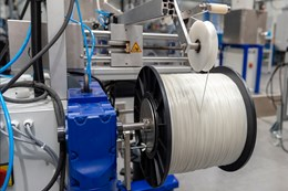 spool of plastic filament made from recycled feedstock