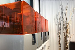 small fleet of 3D printers on a desktop