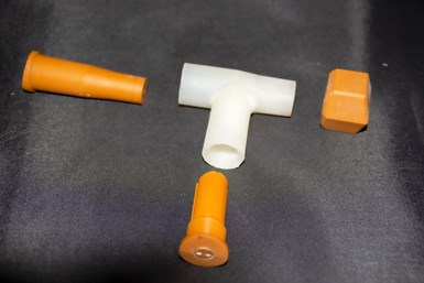 A photo of the T-splitter mold and one set of hand-loaded inserts