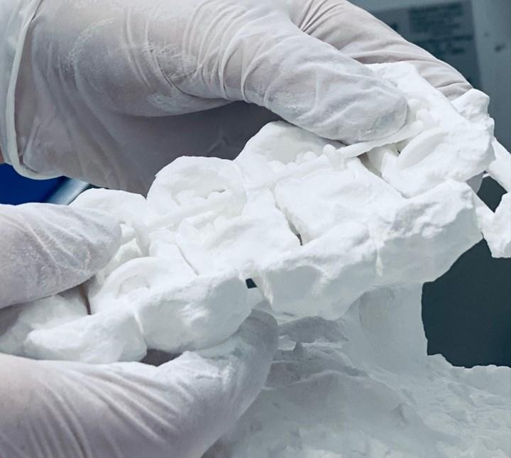 depowdering Tilt Hydrometer brackets from the selective laser sintering process