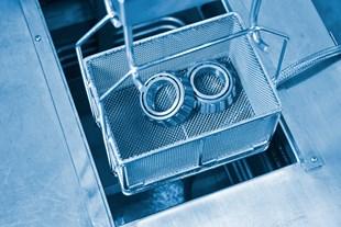 binder jet parts in degreasing basket