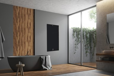 A photo of a bathroom with a free-standing HQ Glass heater on awall near the window