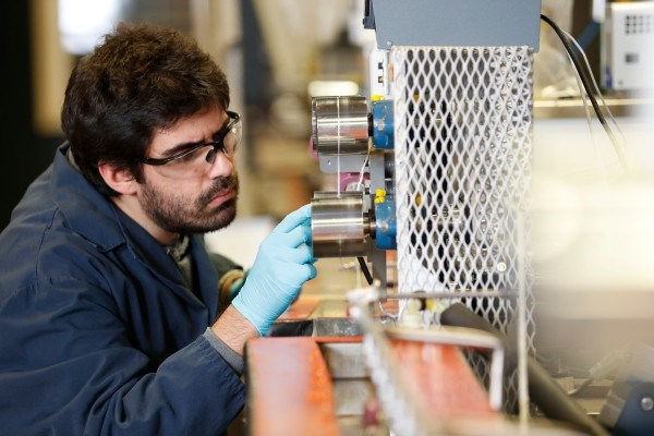 Research engineer works with carbon fiber spinline