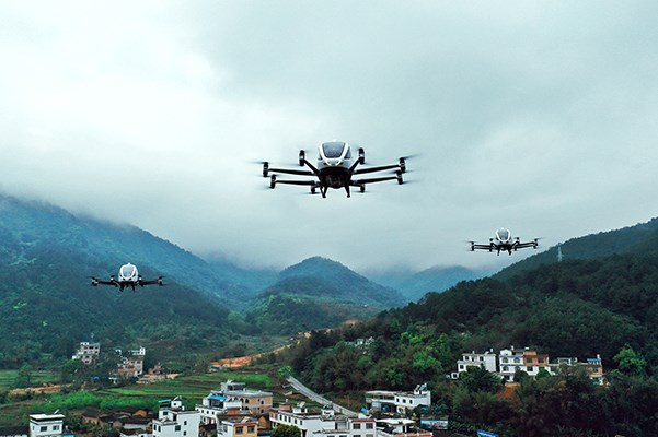 EHang 216 passenger-grade AAVs flying in Hezhou, one of the UCAEZs