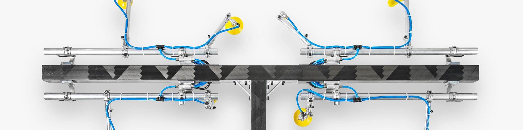 carbon fiber composite T-boom for industrial applications