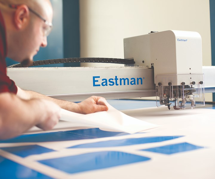 Eastman Machine and operator removing cut material