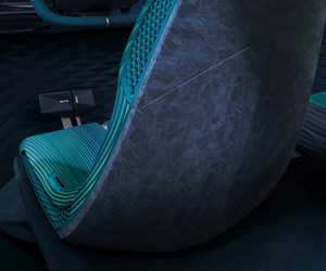 Thermoplastic composites incorporated into vehicle seatback concept