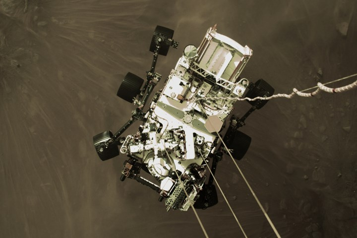 High-res still image taken of the Perseverance rover's descent.