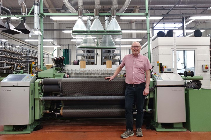 Martin Wood, weaving director at Antich and Sons, pictured with one of the single rapier weaving looms.