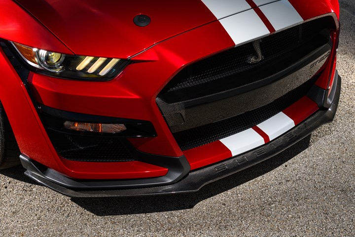 Carbon fiber front splitter component for Mustang Shelby GT500.