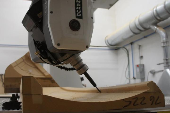 Machining of a part-seating undercut in a medium-density fiberboard fixture.