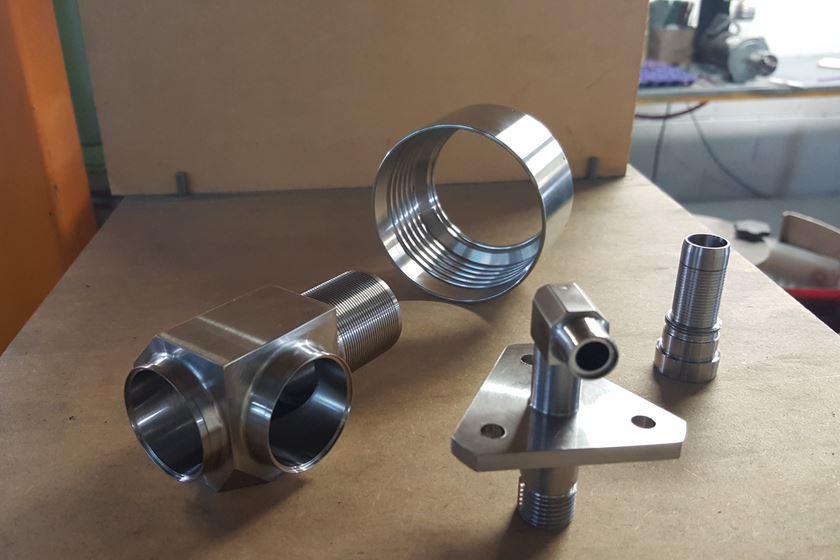 Estas son algunas de las partes que Procesos Control Numérico produce para la industria aeroespacial
