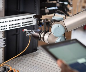 A robot arm inserts an ethernet cable.