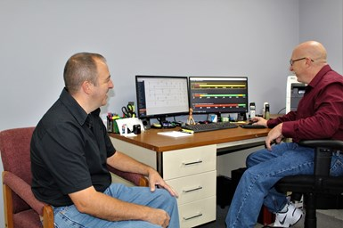 A photo of J&W Swiss owners Jim and Wayne Langlois using Datanomix Fusion
