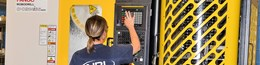 Employee using a FANUC RoboDrill Plus-K automation