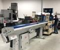 Aztalan employee operating a machine with bar feeder