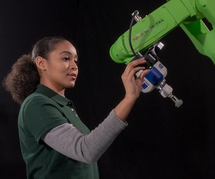 Operator hand guiding a collaborative robot