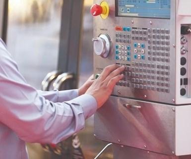 man using a CNC