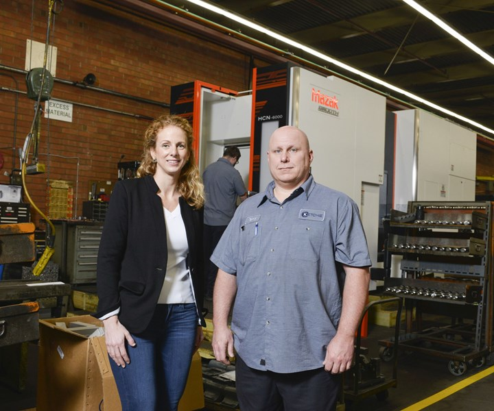 Courtney Silver andTerry Smith of Ketche Inc. in front of a Mazak