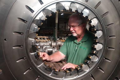 A photo of Greenleaf Sales and Service Engineer Denny Carpenter inspecting OCCO's American GFM FKP45 system