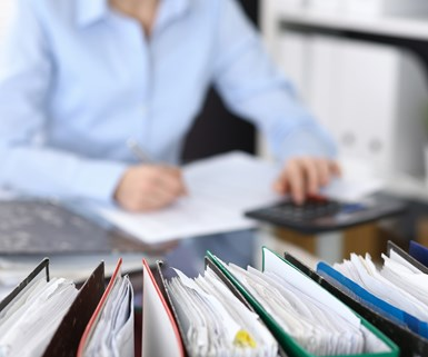 person performing audit at desk
