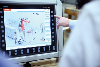 A photo of people using Siemens' Run MyRobot program, which adds precise control to Ingersoll's robotic machines.