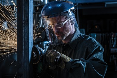 A photo of an industrial worker safely using a Norton abrasive