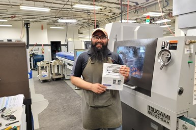 A photo of Paramount machinist Luis Rivas with the documentation for Orbitool