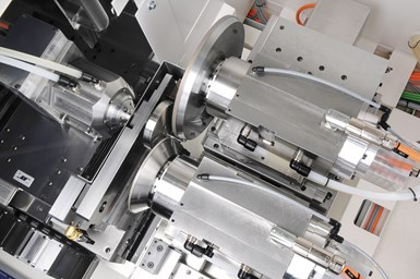A view of the ShapeSmart NP50 pinch and peel grinding machine showing two grinding wheels simultaneously acting on the blank.