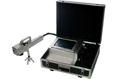 A press photo of Rocklin's MobiLase Fiber Laser Marking system