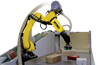 A press image of FANUC and Plus One Robotics' fulfillment solution