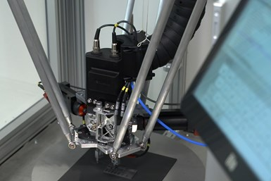 An image of an additive manufacturing machine producing carbide components