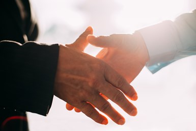A stock photo of two people shaking hands
