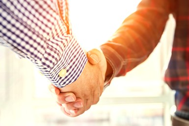 A stock photo of two men shaking hands.