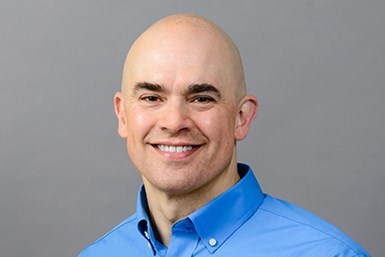 A photo of Dusty Alexander, the second-generation president and CEO of Global Shop Solutions