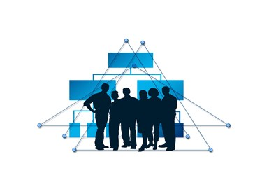 A stock image showing silhouettes of people coming together to discuss business
