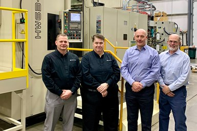 A photo of Mitsui Seiki and Aerodyn executives in front of the HW63TD BA machine