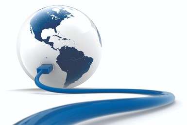 A stock photo of a globe with an ethernet cable plugged into it