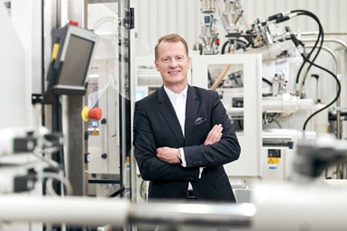 A photo of Michael Ruf, KraussMaffei Group's CEO, surrounded by machines