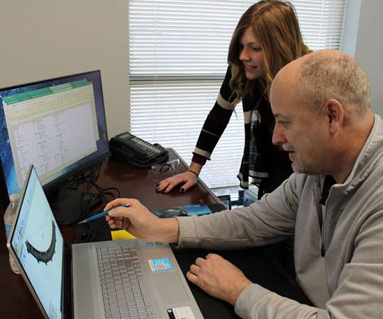 woman and man in front of cad computer