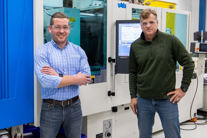 Alex Beaumont (vice president) and John Ralston (president) with a molding machine equipped with Roctool's technology.