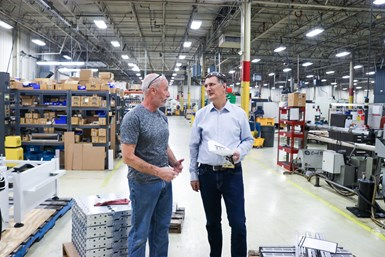 A photo of Tony Butler and JMC VP of Operations Frank Patkunas walking the factory floor
