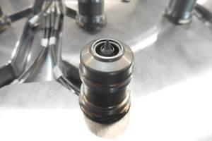 Gate Bushing Minimizes Nozzle Component Damage