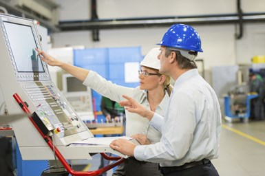 A stock image showing two employees undergoing training on the shop floor