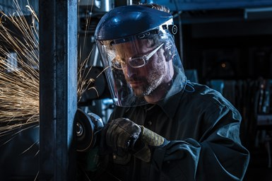 A photo of a worker using a Norton Abrasives product