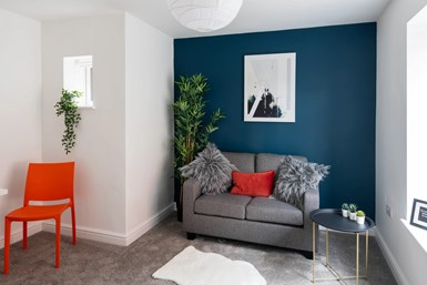 A photo showing an architectural project HMG Paints contributed to, with a blue wall using the company's new MSH colorant
