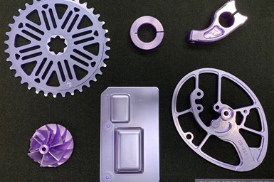 A photo of parts coated with CHEMEON eTCP, showing the coating's distinctive violet coloration